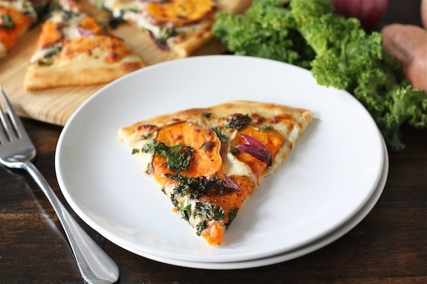 Sweet Potato Kale Pizza Recipe on twopeasandtheirpod.com #recipe