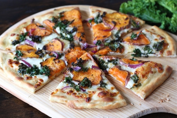 Sweet Potato Kale Pizza Recipe on twopeasandtheirpod.com One of my all-time favorite pizzas!