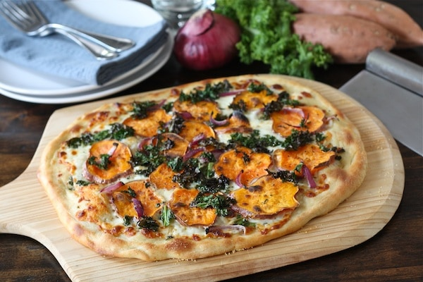 Sweet Potato Kale Pizza Recipe on twopeasandtheirpod.com #recipe #pizza