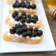 Roasted Blueberry Ricotta Crostini | www.twopeasandtheirpod.com