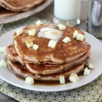 Whole Wheat Apple Cinnamon Pancakes from www.twopeasandtheirpod.com #recipe #pancakes