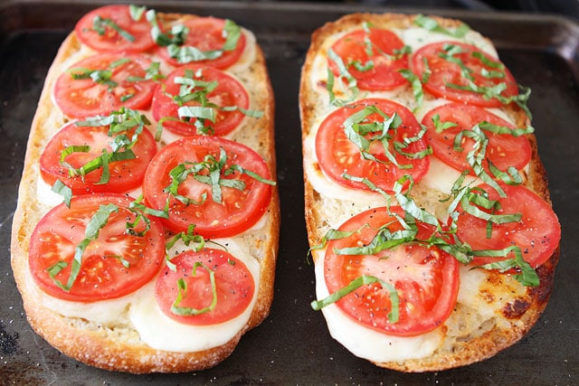Caprese Garlic Bread Recipe on www.twopeasandtheirpod.com The perfect garlic bread for summer!