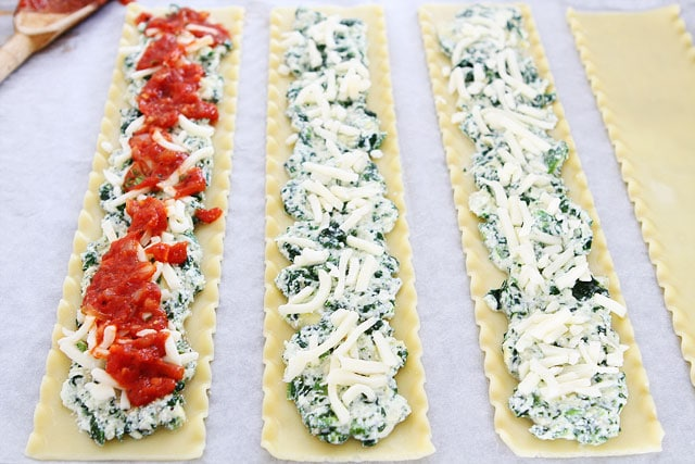Spinach Artichoke Lasagna Roll Ups on twopeasandtheirpod.com