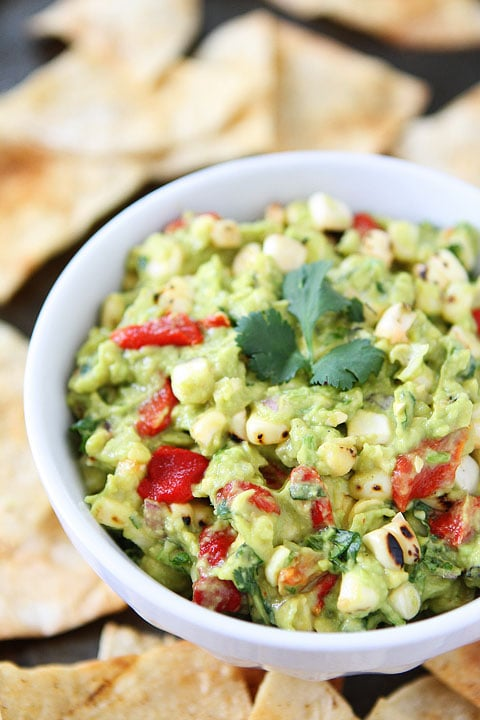 Roasted Corn & Red Pepper Guacamole Recipe on twopeasandtheirpod.com The perfect guacamole for summer!