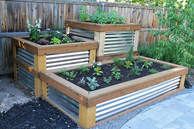 Build Your Own Raised Herb Garden on twopeasandtheirpod.com