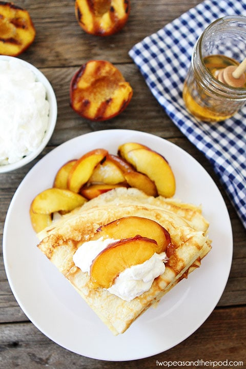 Crepes with Grilled Peaches & Cream Recipe on twopeasandtheirpod.com Perfect summer dessert or breakfast!