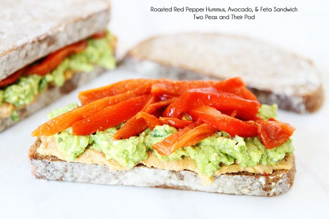 Roasted Red Pepper Hummus, Avocado, & Feta Sandwich Recipe on twopeasandtheirpod.com Love this sandwich!