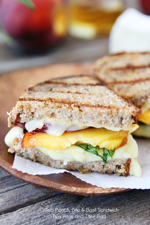 Grilled Peach, Brie, & Basil Sandwich Recipe on twopeasandtheirpod.com A simple summer sandwich with gourmet flavors!
