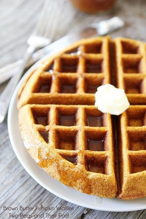 Brown Butter Pumpkin Waffle Recipe on twopeasandtheirpod.com The best pumpkin waffle recipe!