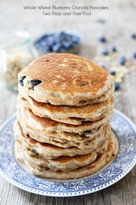 Recipe for Whole Wheat Blueberry Granola Pancakes on twopeasandtheirpod.com I want a big stack of these pancakes!
