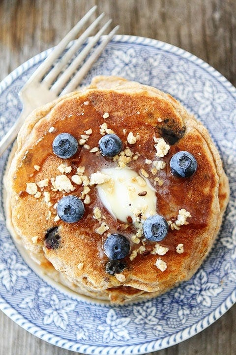 Whole Wheat Blueberry Granola Pancakes on twopeasandtheirpod.com The perfect breakfast!