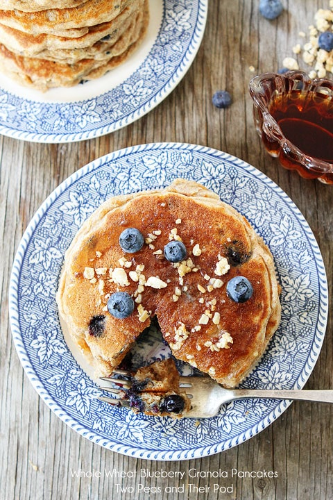 Whole Wheat Blueberry Granola Pancakes on twopeasandtheirpod.com #pancakes #recipe