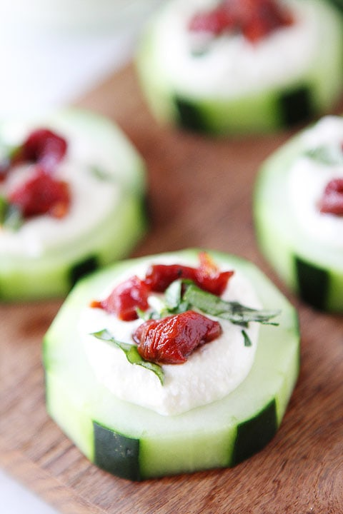 Cucumber Canapés with Whipped Feta, Sun-Dried Tomatoes and Basil on twopeasandtheirpod.com A simple holiday appetizer!