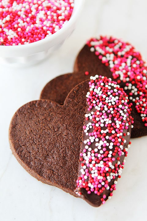 Chocolate Shortbread Heart Cookies on twopeasandtheirpod.com Fun and festive cookies!