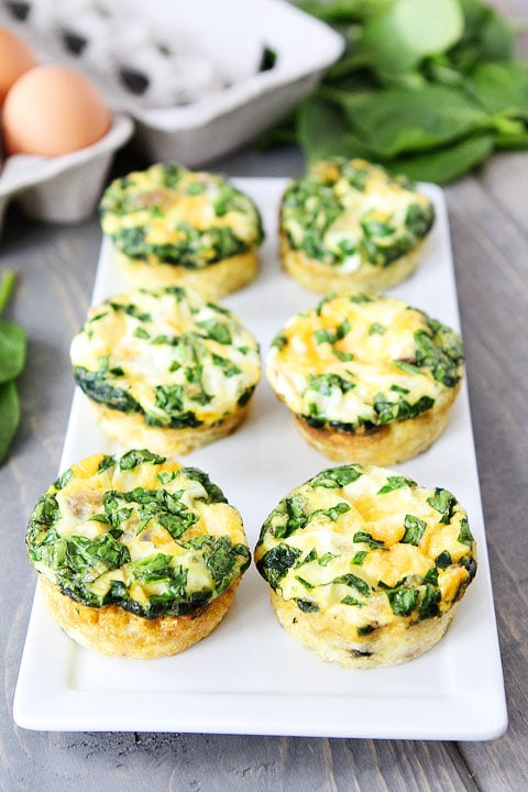 Egg Muffins with Sausage, Spinach, and Cheese Recipe on twopeasandtheirpod.com A fun and delicious breakfast!