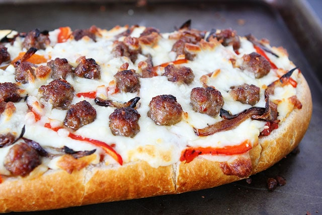 French Bread Pizza Recipe on twopeasandtheirpod.com Perfect game day food!