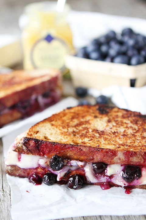 Blueberry, Brie and Lemon Curd Grilled Cheese Recipe on twopeasandtheirpod.com Love this sweet grilled cheese!