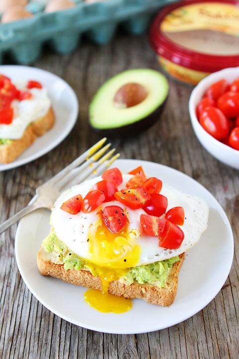 Avocado, Hummus, and Egg Toast Recipe on twopeasandtheirpod.com Love this easy and healthy recipe!