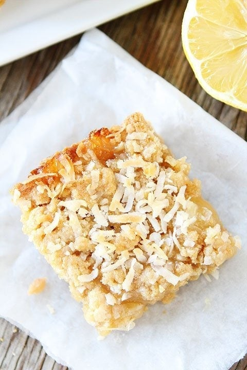 Lemon Coconut Crumb Bars Recipe on twopeasandtheirpod.com These bars are easy to make and SO good!