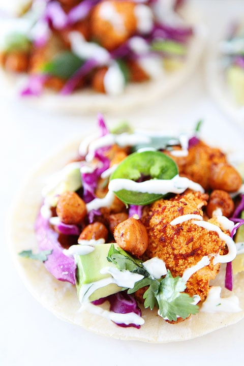 Roasted Cauliflower and Chickpea Tacos Recipe on twopeasandtheirpod.com The BEST tacos!