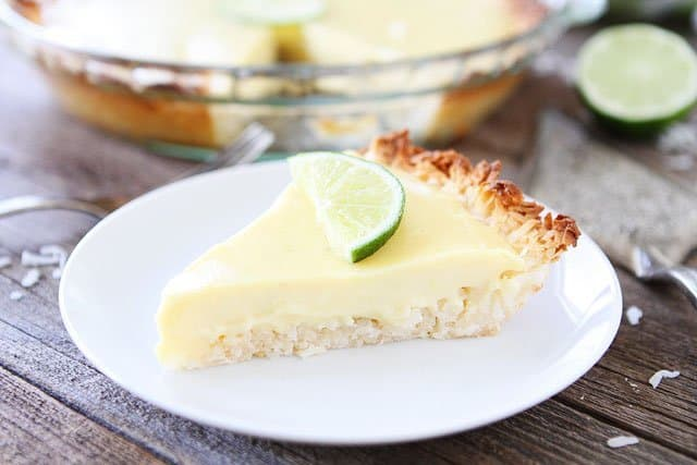 Key Lime Pie with Coconut Macaroon Crust Recipe on twopeasandtheirpod.com. The coconut macaroon crust make this key lime pie extra special!