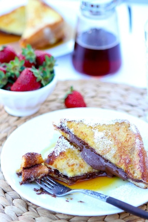 Nutella Stuffed French Toast Recipe on twopeasandtheirpod.com. This decadent French toast recipe is perfect for special occasions!