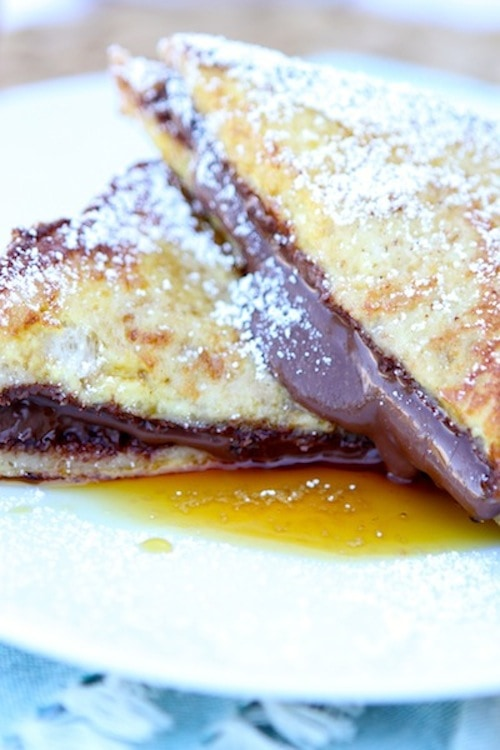 Nutella Stuffed French Toast Recipe on twopeasandtheirpod.com. Nutella lovers will go crazy for this decadent French toast recipe!