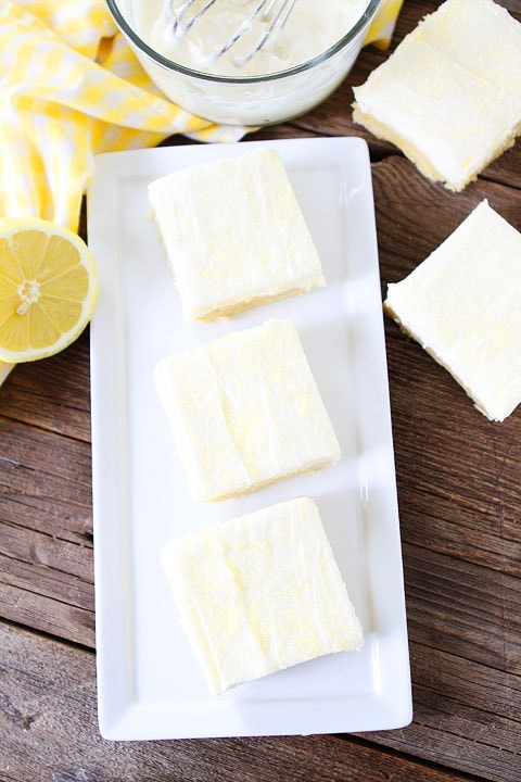 Lemon Sugar Cookie Bars Recipe on twopeasandtheirpod.com. Sugar cookie bars with lemon cream cheese frosting! A favorite at our house! #lemon #bars #dessert