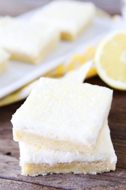 Lemon Sugar Cookie Bars Recipe on twopeasandtheirpod.com. Perfect bars for parties! Love the lemon cream cheese frosting! #lemon #dessert