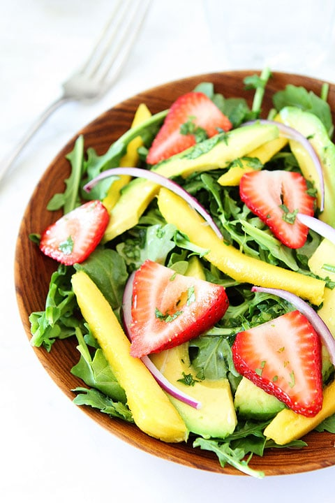 Mango, Strawberry, and Avocado Arugula Salad Recipe on twopeasandtheirpod.com. Love this gorgeous and simple salad! #salad #glutenfree #vegan