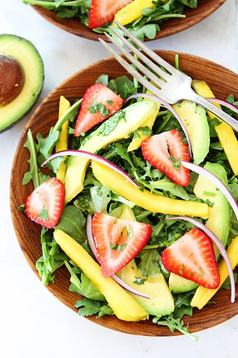 Mango, Strawberry, and Avocado Arugula Salad Recipe on twopeasandtheirpod.com. #salad #glutenfree #vegan