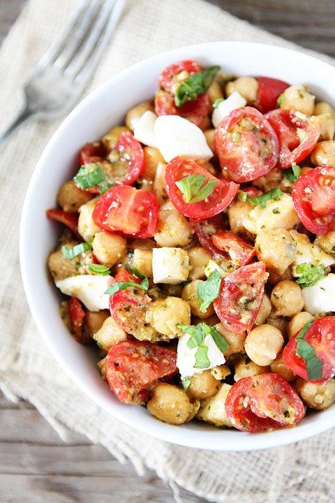 Chickpea, Pesto, Tomato, and Mozzarella Salad Recipe on twopeasandtheirpod.com Only 4 ingredients needed to make this healthy salad!