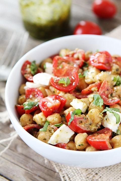 Chickpea, Pesto, Tomato, and Mozzarella Salad Recipe on twopeasandtheirpod.com You can make this healthy salad in under 10 minutes! #salad #recipe