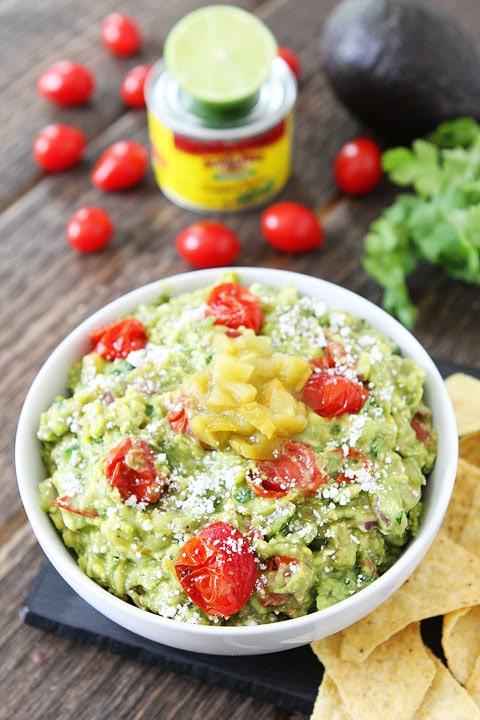 Green Chile and Roasted Tomato Guacamole Recipe on twopeasandtheirpod.com LOVE this guacamole recipe!
