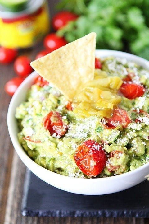 Green Chile and Roasted Tomato Guacamole Recipe on twopeasandtheirpod.com Serve with chips or along side your favorite Mexican dish! #recipe