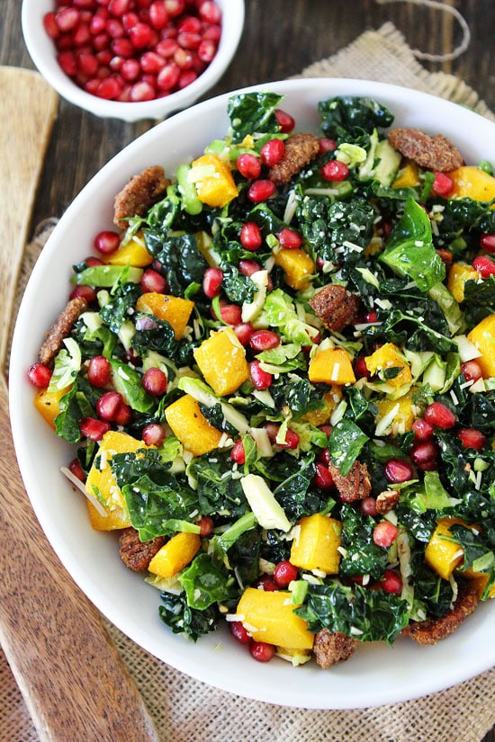 kale and brussels sprouts salad with butternut squash pomegranate and
