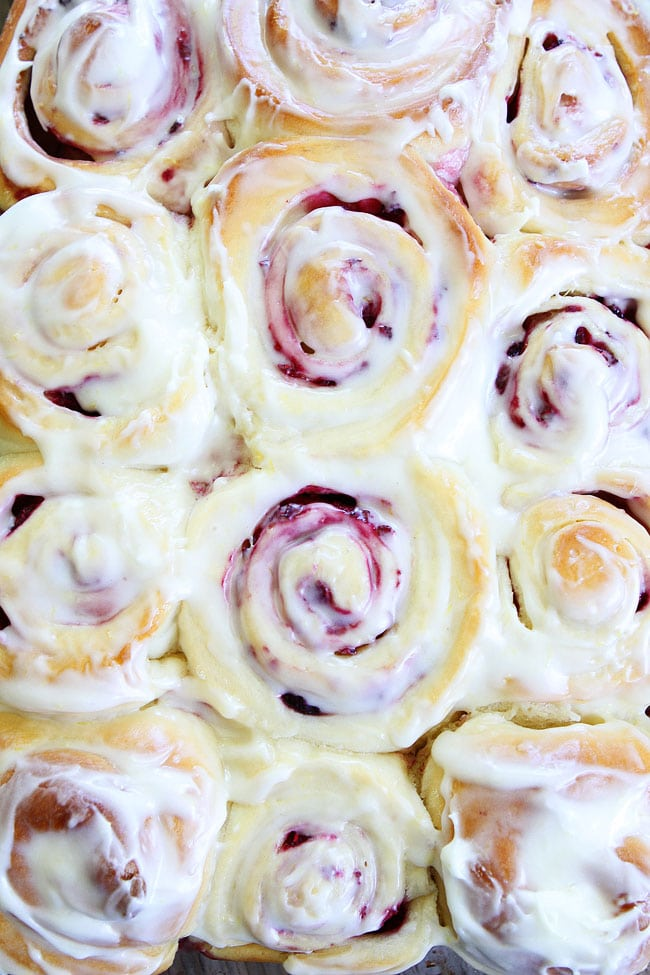 ... raspberry yeast rolls topped with cream cheese frosting. These rolls