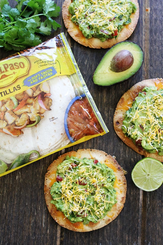 Cheesy Guacamole Tostadas Recipe on twopeasandtheirpod.com These easy ...