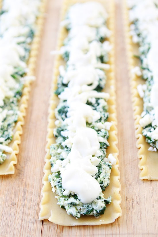 Pesto Lasagna Roll Ups Recipe on twopeasandtheirpod.com Cheesy pesto ...