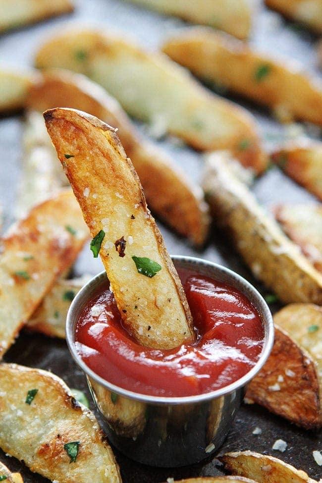 Baked Garlic Parmesan Potato Wedges Recipe on twopeasandtheirpod.com ...