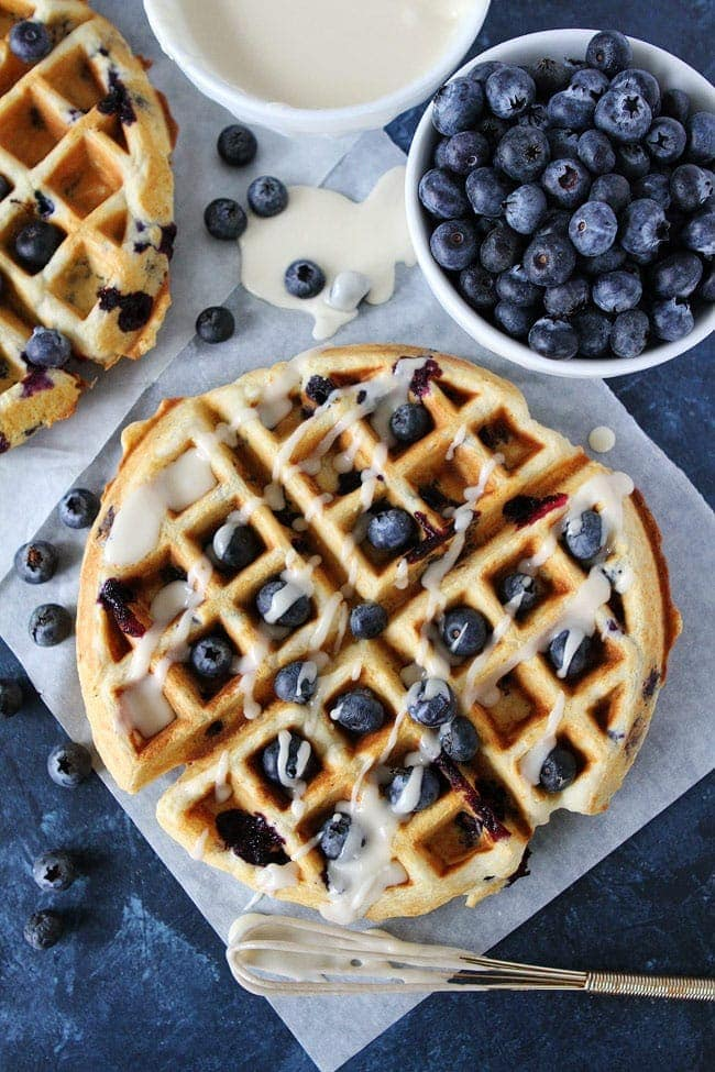Blueberry Sour Cream Waffles with maple glaze drizzle
